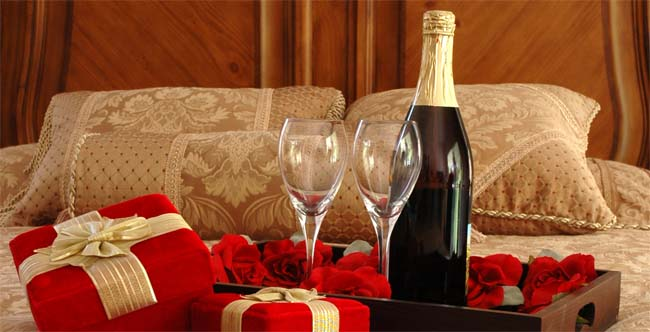romantic dinner plans with gifts, champagne and flowers