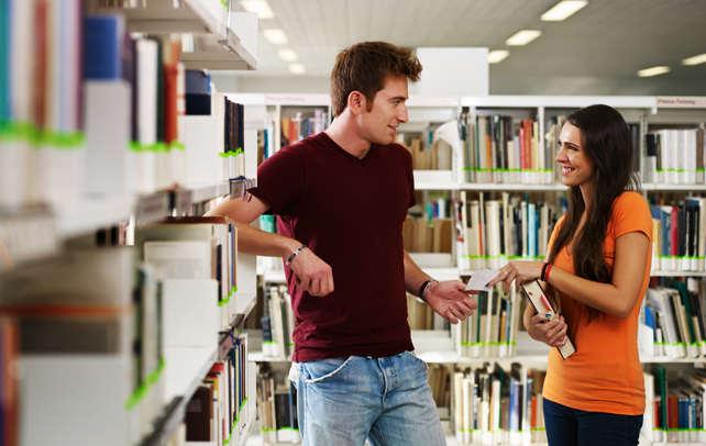 A girl seeking his boyfriend's advice in the library