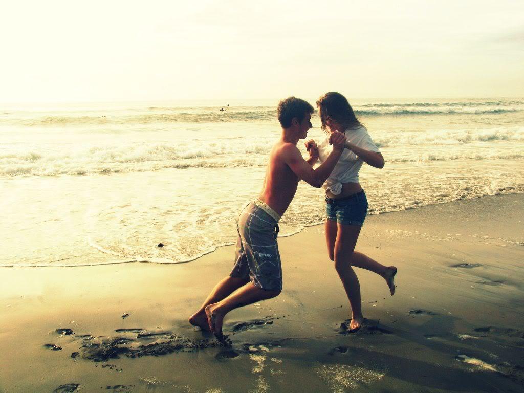 boyfriend girlfriend romantically fighting on the beach